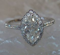 1.10ct Marquise diamond engagement ring set in 14K white gold with a halo of micro pave diamonds.
