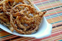 Onion Strings – thin slices of onion, soaked in buttermilk dipped in a spiced flour and fried to perfection. They're great on top of your favorite burger, steak or just by themselves! I think I've discovered the next best thing to bacon and slice bread! These Onion Strings!!! Seriously, have you made these yet? Well,... Read More »