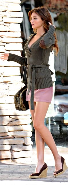 Miranda Kerr - sweater over dress. more wearable for day time