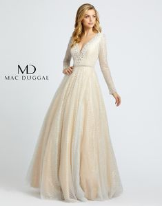 This long sleeved gown has a V-neckline with sheer panel inset. The triple embellished bands at the waist are sure to flatter your figure. Embellishments include pearls along the neckline, wrists, and open back. Evening Gowns With Sleeves, Prom Dresses Long With Sleeves, Ball Dresses, Ball Gowns, Club Dresses, Evening Dresses, Nude Formal Dresses, Prom Boutiques, Long Sleeve Gown