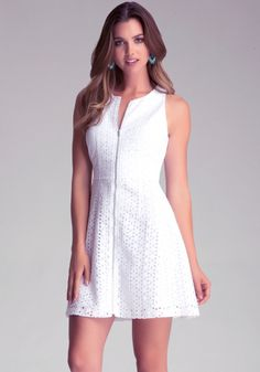 Your eyelet wishes have come true with our sexy cutout tank dress that features a full zippered front and an on-trend circle dress style. Slight peplum flare.