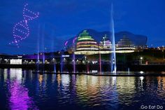 Drones form the shape of the DNA double helix in night sky above the Sage Gateshead during the Great Exhibition of the North opening exhibition.