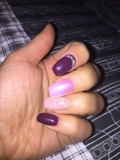 Pretty burgundy nails with pink glitter