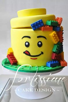 Lego Man Head Cake with Solid Chocolate Lego Blocks by Tortissime Cake Design.