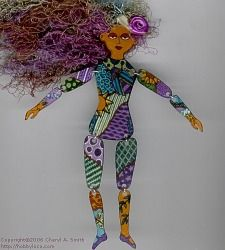 "Shrinky Dink Art Doll ~ was created from an original 9 piece pattern. My colorful summertime ""doodle"" design was done with a black ultra-fine sharpie marker and colored pencils.  I punched a row of holes across the top of her head before shrinking, & attached colorful fibers to create her hair. I added the little purple satin rose with craft wire.  The body sections were joined with jump rings."