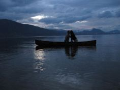 """#CanoeLove entry from Jacqueline Huard. #sunset #kiss See the newest exhibition at The Canadian Canoe Museum: """"The story of paddling and romance. Can I canoe you up the river?"""" #Contest #Canoe https://canoemuseum.ca/CanoeLove Okanagan Lake, BC"""