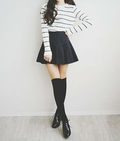 Monochrome striped loose jumper with a black skater skirt, black knee high socks and black boots