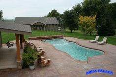 Fiberglass pool, stamped concrete, custom auto cover bench with added water feature, guest house.   Aqua Palace  810 Woodbury Ave  Council Bluffs, Iowa 51503  712-329-4180  www.aquapalace.com