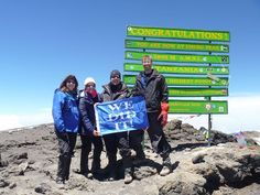 The new, green sign at the summit of Mount Kilimanjaro replaced the wooden, iconic sign at Uhuru Peak in January 2012. Photo taken by Thomson Trekker, Leslie Biggs.