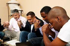 Men Praying | Group Of Men Praying Together With An Open Bible