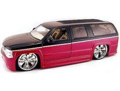 This Chevrolet Suburban Diecast Model Car is Red and Black and features working steering, wheels and also opening bonnet with engine, boot, doors. It is made by Jada and is 1:18 scale (approx. 27cm / 10.6in long).    The latest automotive trends from Dub City! Hottest modified cars to hit the street, with massive chrome Spinners and cool paint work. Be one of the first in the country to get your hands on these cool modified street cars!...
