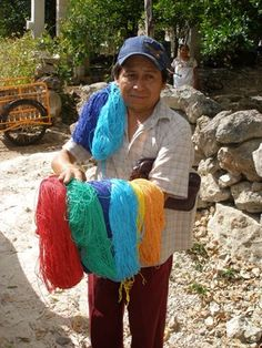 An Arm-full of Colors. Collecting handmade Mexican hammocks in the villages of the Yucatan.
