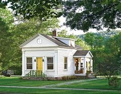 I'm so excited to live in a real house next year. A little white cottage right across from campus! (not this one of course)