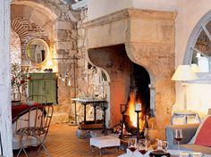 original stone mantel in c. hunting lodge in Agen, France. I wish I had a hearth just like this in my kitchen!