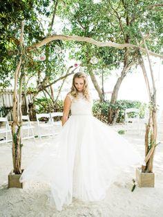 A-line wedding dress: Wedding Dress: BHLDN - http://www.bhldn.com Photography: Care Studios - www.careweddings.com Read More on SMP: http://www.stylemepretty.com/2017/06/16/florida-beach-wedding/