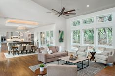 An open concept floor plan works well for this light and bright home with its white walls and ceiling and tons of windows. Sliding glass doors set up an easy-in, easy-out flow that helps to bring the outdoors in.