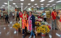 I was one of the early-bird customers at 8 a.m. last Friday as Trader Joe's opened its new 13,000-square-foot grocery store in the Rose Pavilion, joining scores of other shoppers dashing in after a festive ribbon-cutting.