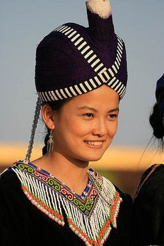 Hmong turban, believed to maybe be representation of Hmong flag from when we lived in China. The white and black cloth was a new adornment when Hmong migrated to Laos.