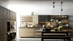 valcucine's new 'sinetempore', designed by gabriele centazzo, is a marriage of industrial processing and handicraft. the kitchen system values ancient techniques like carvings, inlays, mosaics and pyrography, by applying them to the finish of the contemporary cooking space's cabinets and work surfaces.