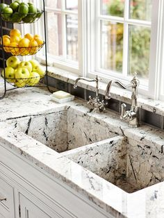 Custom Creation - Granite countertops that feature smatterings of grays and blacks on ivory. The sink was custom crafted from the same granite as the countertop and features a deep basin and two faucets.