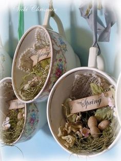 Cup spring nests! - especially love the little doily - teacup, moss nest, eggs, tiny flowers (polymer?) and word tag Easter or spring decoration
