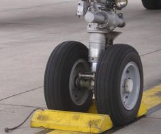 Chocks*** are used to prevent an #aircraft from moving while parked at the gate or in a hangar. #Chocks are placed in the front ('fore') and back ('aft') of the wheels of landing gear. They are made out of hard wood or hard rubber......