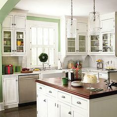 Classic Materials | The builder of this home made classic choices such as the white subway tile, the vintage-style hardware on the cabinets, and a mahogany top on the island. | SouthernLiving.com