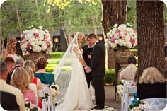 love these two huge flower bouquets on either side of the ceremony altar in huge urns instead of vases