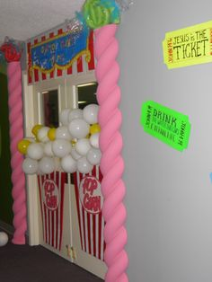 Entry door and Hallway tickets to Cotton Candy Café. Candy up top are pool noodles and cardboard popcorn boxes with balloon popcorn
