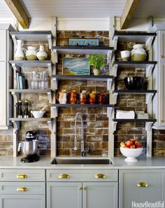 """Guess what? It's not brick,"" says designer Ken Fulk of the accent wall in a New Orleans kitchen. ""It's this wonderful rough-hewn terracotta tile, and we used it all across the wall and up to the ceiling, so it has more impact than the typical backsplash."" Click through for more kitchen backsplash ideas."