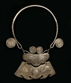 China | Antique necklace from the Dong people, Guizhou Province.  The fish on the lower section of the pendant are more than likely recalling the 'Taijitu' Taoist symbol of Ying and Yang | Silver | ca. Early 20th century.