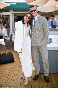 A vision in white: Frieda Pinto was pictured cuddling up to movie star Luke Evans