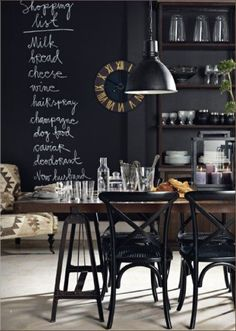 chalkboard wall, black pendant lights, restoration chairs, wood table.Love all these elements together. Classy, stylish, clean, approachable.