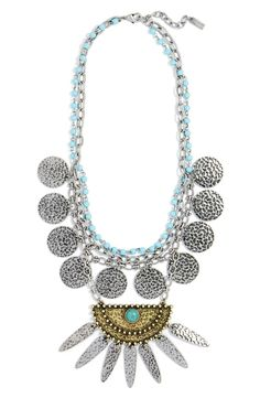 Loving this fierce statement necklace that features hammered, antiqued metal plates and bright turquoise-hued stones for a boho-chic mix of texture and finish.