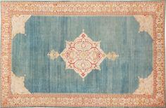 Luxurious antique Turkish Oushak Rug with a chic octofoil medallion.