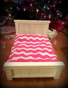 Handcrafted doll bed with Chevron bedding, perfect for American Girl dolls.