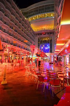 Oasis of the Seas. Stroll the only boardwalk at sea by night with an ice cream cone from Cups and Scoops in hand.