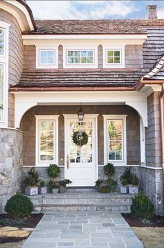 The cedar shake that is used for the siding is stained in Sherwin Williams Blue Shadow semi-transparent. The trim is Benjamin Moore Winter Winter in semi-gloss.    The stone is Swannanoa | http://homedesignphotoscollection.blogspot.com