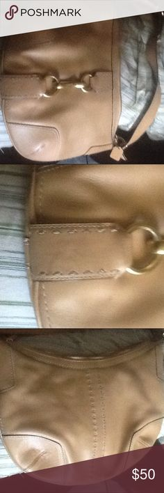 """Authentic Coach Bag Beautiful """" authentic"""" via his shoulder bag - measures 13.5 by 9.5 - in great condition -  beautiful tan color with hold hardware - inside has zip pocket plus 2 cell style pockets - inside very clean ( see pic 2) slight mark on bottom of bag ! Strap is adjustable Coach Bags Shoulder Bags"""