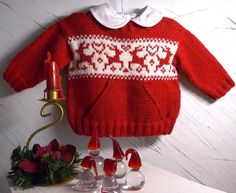 This sweet little Christmas jumper has a big front pocket (to keep their special little trinkets in), with Reindeers and love hearts splashed across the chest. Pattern comes with Fair Isle charts for each individual size. You will need 3 {4 : 4 : 5] balls of yarn in the Main colour plus a small amount of the contrast colour. You could break away from the traditional red and white and use blue and white, which also looks very effective.