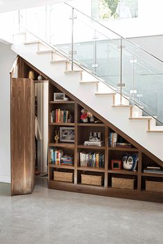 Let your hobbies be a welcome mat for your home : An under-the-stairs unit reflects Molly Graves' organizational bent. Photo: Sarah Hebenstreit, Modern Kids Co. Home Stairs Design, Home Interior Design, House Design, Modern Interior, Design Design, Staircase Storage, Stair Storage, Storage Under Stairs, Staircase Bookshelf