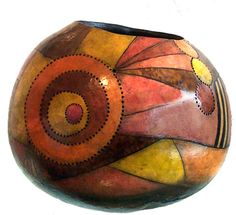 Beth McClure    This is a thick skinned gourd  All of the colors are wood stains  with detail painting in black acrylic  Some details are burned into the gourd