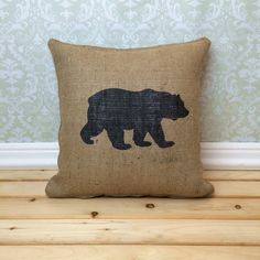 Our Bear Pillow is a fun accent for your cabin or to give as a Cabin Warming Gift! It works well as a rustic home decor accent and can be used year round! The pillow is made from all natural jute burlap.  This burlap pillow looks great paired with our  Deer head pillow cover~ https://www.etsy.com/listing/188958740/deer-head-pillow-deer-silhouette-antlers  and  Moose Pillow Cover~  https://www.etsy.com/listing/192699895/moose-pillow-cover-hunting-pillow-rustic?ref=shop_home_active_1  Details…