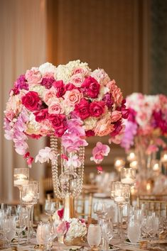 Centerpiece with Shades of Pink     Photography: Carasco Photography   Read More:  http://www.insideweddings.com/weddings/wedding-filled-with-vibrant-pink-florals-and-peruvian-traditions/912/