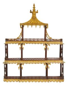 A DELICATE CHIPPENDALE STYLE MAHOGANY AND PARCEL GILT WALL SHELF Early 20th Century