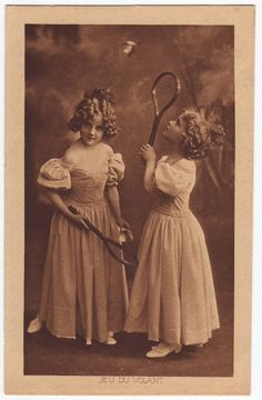 Antique belgian sepia postcard with the portrait of two young girls playing badminton