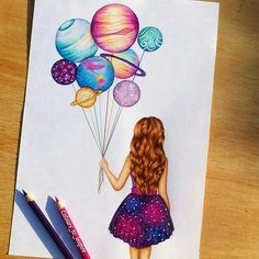 A girl holding planet balloons. What a fun way to explore Space!