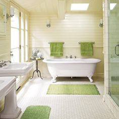 Read these tips before you redo a bathroom ......bathroom with clawfoot tub, hex tile, wainscoting, and green accents