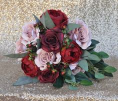 This faux flower bouquet is rich with color, made with dusty pink roses, burgundy peonies, wine roses and eucalyptus that are silk flowers. See more here: https://www.etsy.com/listing/491464755/brides-bouquet-wedding-bouquet-bride?ref=listing-shop-header-1