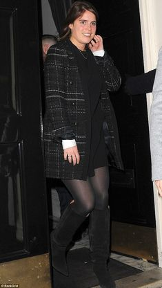 Happy: Princess Eugenie put on a giddy display on Monday as she was pictured on a fancy night out with her new fiancé and sister Princess Beatrice